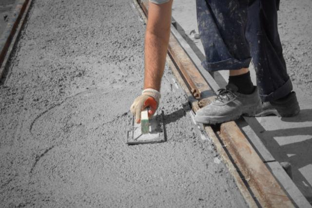 Concrete resurfacing worker